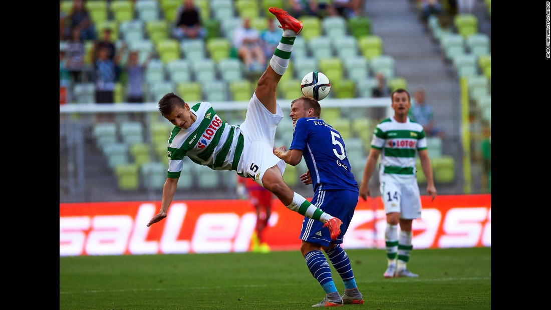 Adam Dzwigala, a defender from Polish soccer club Lechia Gdansk, takes a fall while playing German club Schalke during an exhibition match Wednesday, July 22, in Gdansk, Poland.