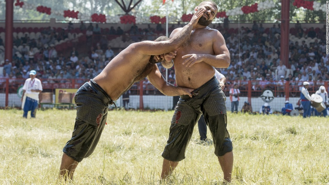 Orhan Okulu, left, and Fatij Atli compete in the 654th annual Kirkpinar Oil Wrestling Festival in Edirne, Turkey, on Sunday, July 26. It's the oldest sanctioned sporting competition in the world.