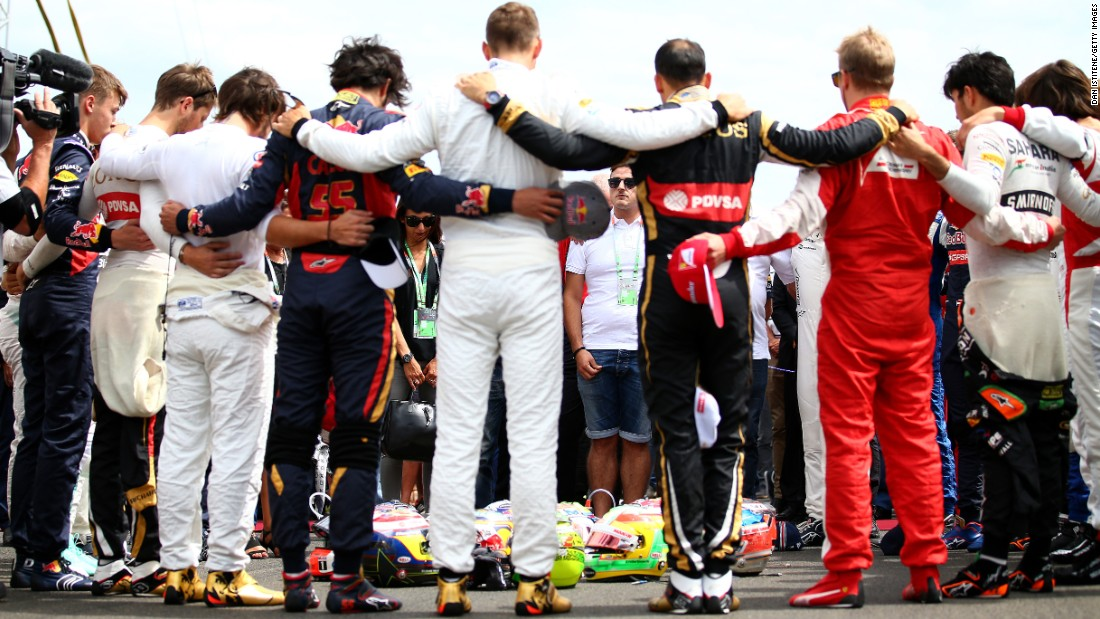 "Formula One drivers and members of Jules Bianchi's family observe a moment of silence for Bianchi before the Grand Prix of Hungary on Sunday, July 26. Bianchi, an F1 racer from France, <a href=""http://www.cnn.com/2015/07/18/motorsport/formula-one-jules-bianchi-dies/"" target=""_blank"">died July 17</a> from the head injuries he suffered nine months ago in the Japanese Grand Prix. Bianchi was 25."