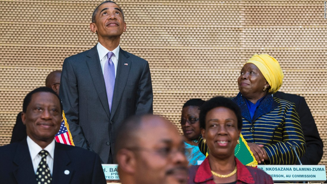 Dr. Nkosazana Dlamini-Zuma, right, chairwoman of the African Union Commission, stands with Obama as he looks up at the crowd before delivering a speech to the African Union on July 28.