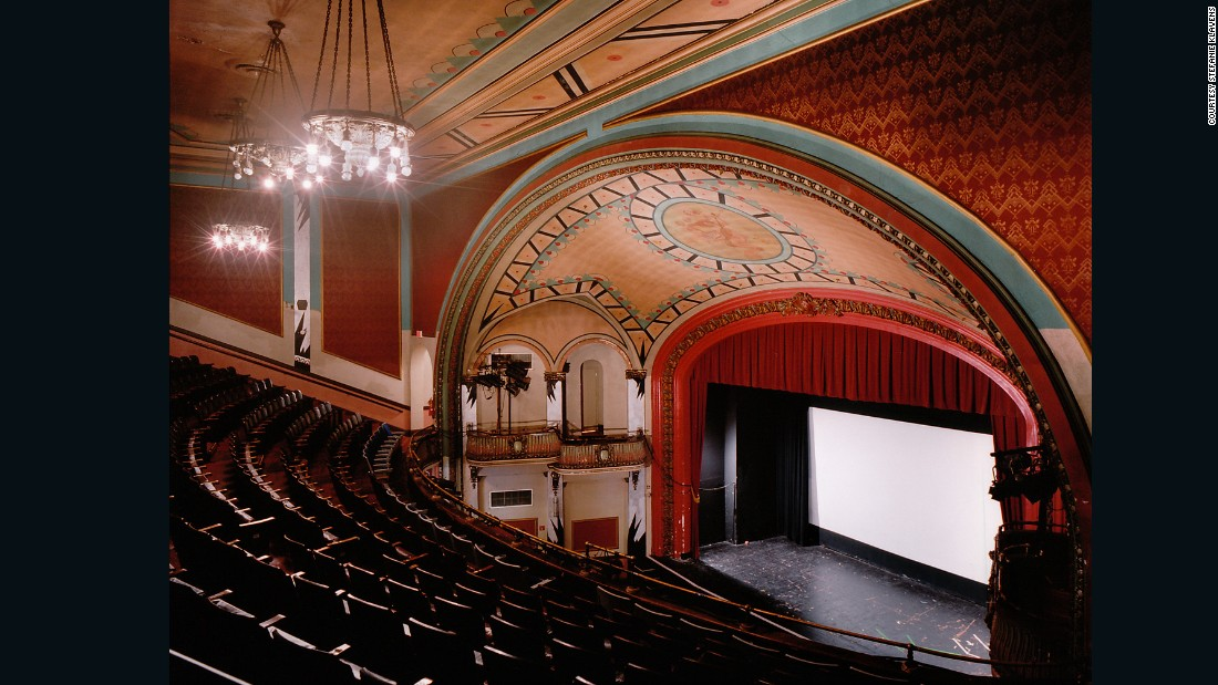 "This theater, built in 1914, was designed primarily for stage performances, opera and films, which were relatively new at the time. <br />Now it shows the very latest film releases and special film series, including classics such as Boogie Nights and Jaws. <br />What are these old school cinemas like when the films are over? ""It's very contemplative,"" says Klavens. <br />""I work with long exposures in the theaters interiors  -- I don't add any lights -- and sometimes it is quite dark, and details come out that are not even visible to me."""