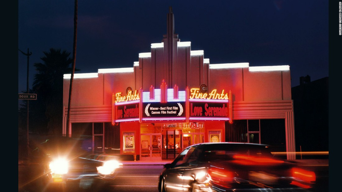 "When it first opened in 1937, this theater showed ""That Girl From Paris"" and ""Black Legion."" <br />The glittering exterior of theaters like these inspired Klavens' project -- ""I love standing outside at dusk and watching the light change,"" she says. <br />""As daylight fades and the electric street lights and neon marquees become more prominent it totally changes the scene, and I enjoy the shifting light and shooting just at the 'magic hour.' <br />""I'm also fascinated by the many decorative details in the interiors, and how different it was in that era, compared to the approach to the design of public spaces today."""