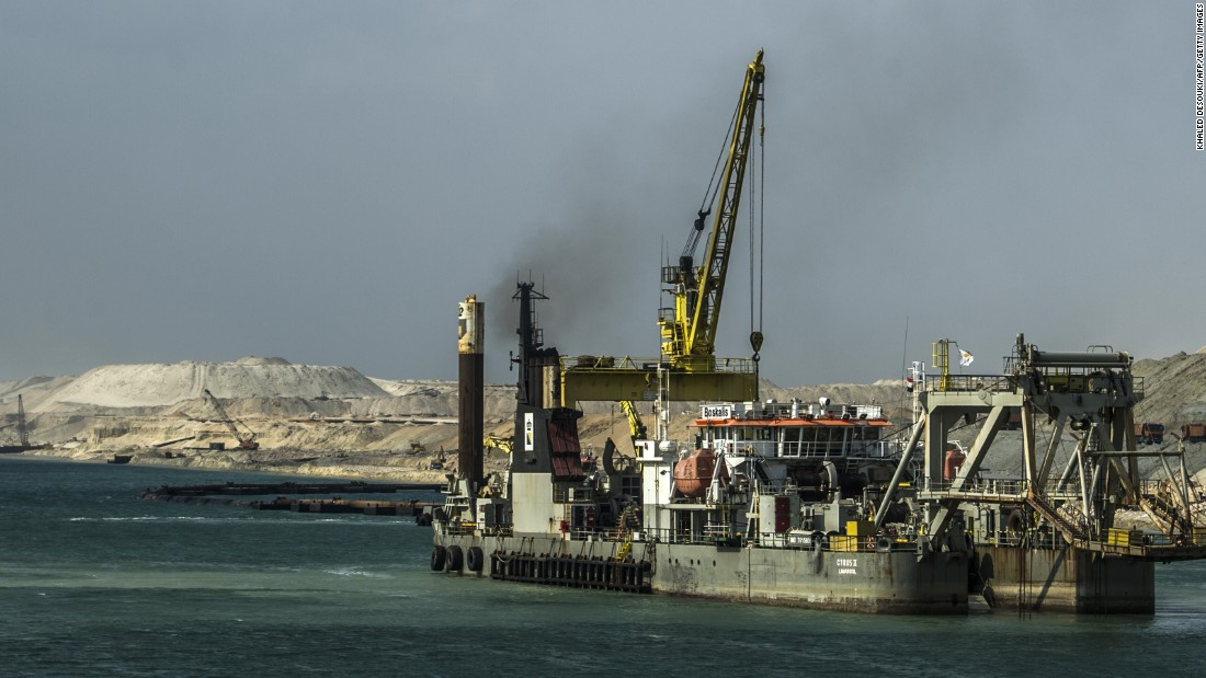 A dredger is seen at work on the new waterway of the Suez Canal on June 13, 2015, in the port city of Ismailia, east of Cairo. Dubbed the Suez Canal Axis, the new 72-kilometer project is aimed at speeding up traffic along the existing waterway and boosting revenues for Egypt. 41,000 people have been working since construction began last August, moving a total of half a trillion cubic meters of earth -- equivalent to moving 200 Great Pyramids.