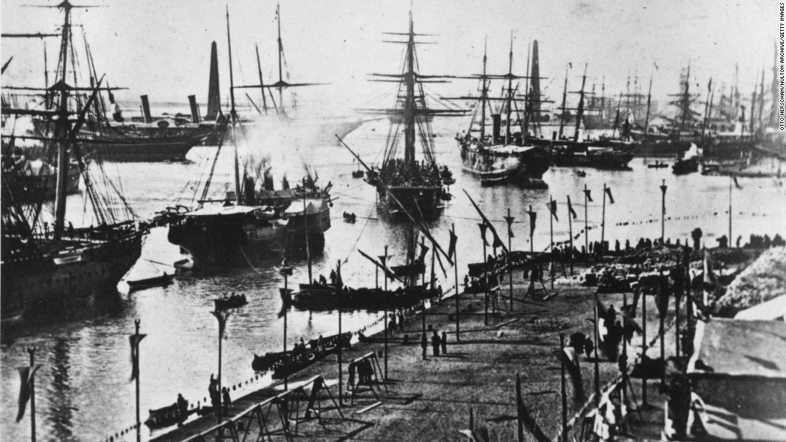 A fleet of ships enter the Suez Canal at its inauguration on November 17, 1869. Egypt was the first recorded country to dig a man-made canal across its land for international trade. Connecting the Mediterranean Sea to the Red Sea via the Nile, the Suez Canal is the shortest route between the east and the west.