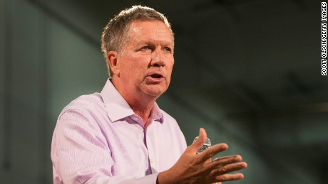 Republican presidential candidate Ohio Governor John Kasich speaks to guests gathered for a town hall meeting at Doll Distributing on July 24, 2015 in Des Moines, Iowa.