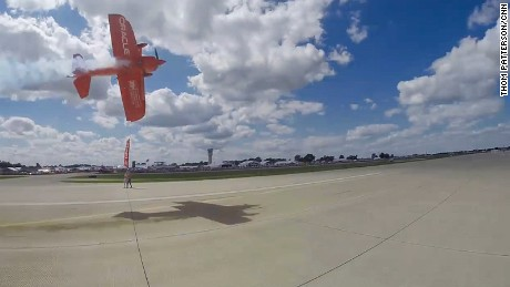 Tucker flies his plane sideways -- dangerously close to the ground -- during a performance last week.