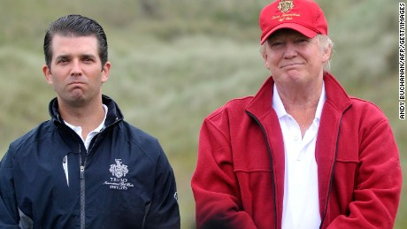 US tycoon Donald Trump (R) and his son Donald Jnr pose for pictures as they officially open his new multi-million pound Trump International Golf Links course in Aberdeenshire, Scotland, on July 10, 2012.
