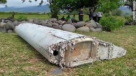 "This image taken from video, shows a piece of debris from a plane, Wednesday, July 29, 2015, in Saint-Andre, Reunion. Air safety investigators, one of them a Boeing investigator, have identified the component as a ""flaperon"" from the trailing edge of a Boeing 777 wing, a U.S. official said. Flight 370, which disappeared March 8, 2014, with 239 people on board, is the only 777 known to be missing. (Reunion 1ere via AP) FRANCE OUT"