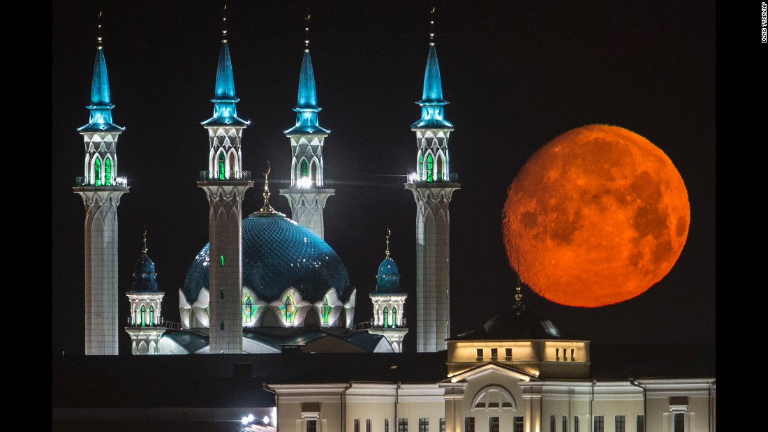 A full moon rises in Kazan, Russia, on Wednesday, July 29. At left is the Qol Sharif mosque.