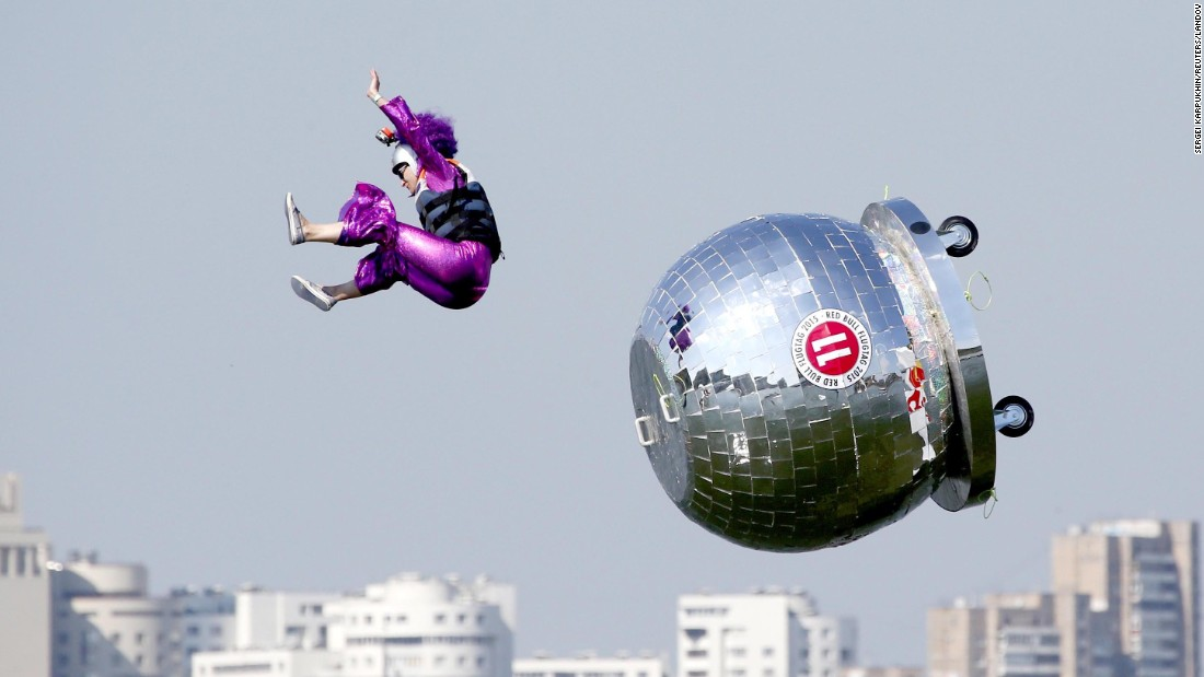 "A participant falls during the Red Bull ""Flugtag"" event in Moscow on Sunday, July 26. In Flugtag, which means ""flying day"" in German, everyday people pilot homemade gliders off a 30-foot deck and into water -- in this case, the Moskva River. The contestants are judged not only on their distance, but their creativity and showmanship."