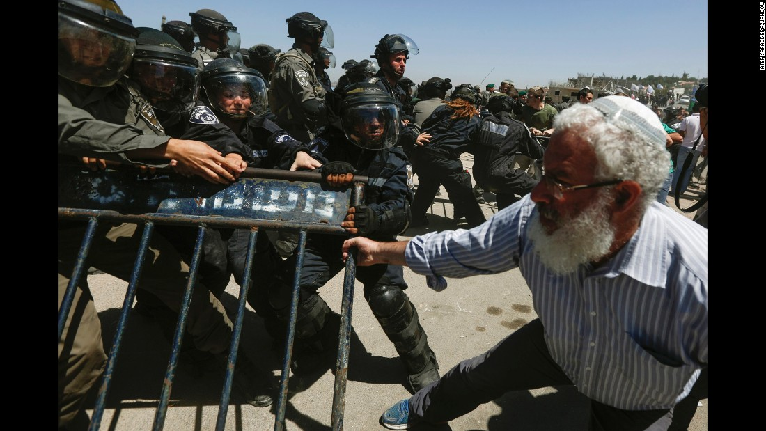 Israeli security forces scuffle with Israeli settlers from the West Bank settlement of Beit El during the demolishing of 24 housing units on Wednesday, July 29. Israel's Supreme Court ruled that the housing units had been built illegally and must be demolished.