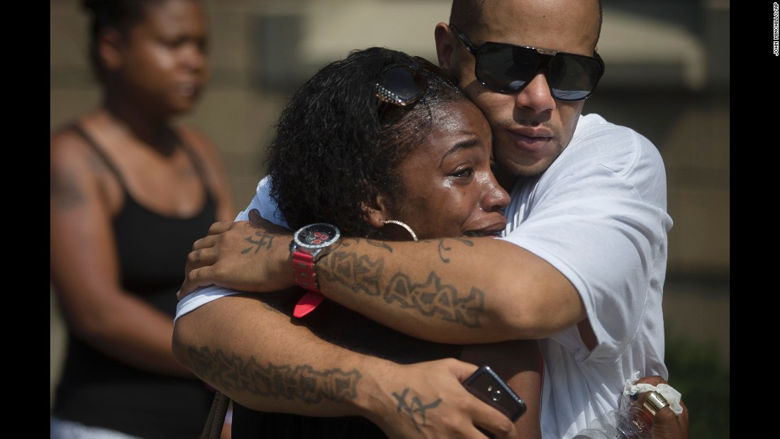 "Shanicca Soloman cries in the arms of her friend Terrell Whitney outside funeral services for Samuel DuBose on Tuesday, July 28. Dubose, 43, <a href=""http://www.cnn.com/2015/07/30/us/ohio-sam-dubose-tensing/"" target=""_blank"">was fatally shot </a>July 19 by a University of Cincinnati police officer who stopped him for a missing license plate. The officer, Ray Tensing, was fired from his job. He has pleaded not guilty to charges of murder and voluntary manslaughter."