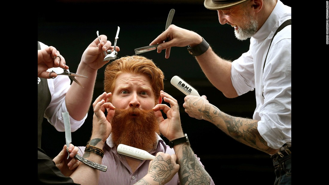 Chris Moriarty has his beard prepared on Friday, July 24, ahead of the Great British Barber Bash in Glasgow, Scotland. Scotland's best barbers came together to demonstrate their flair for hair, beards and mustaches.