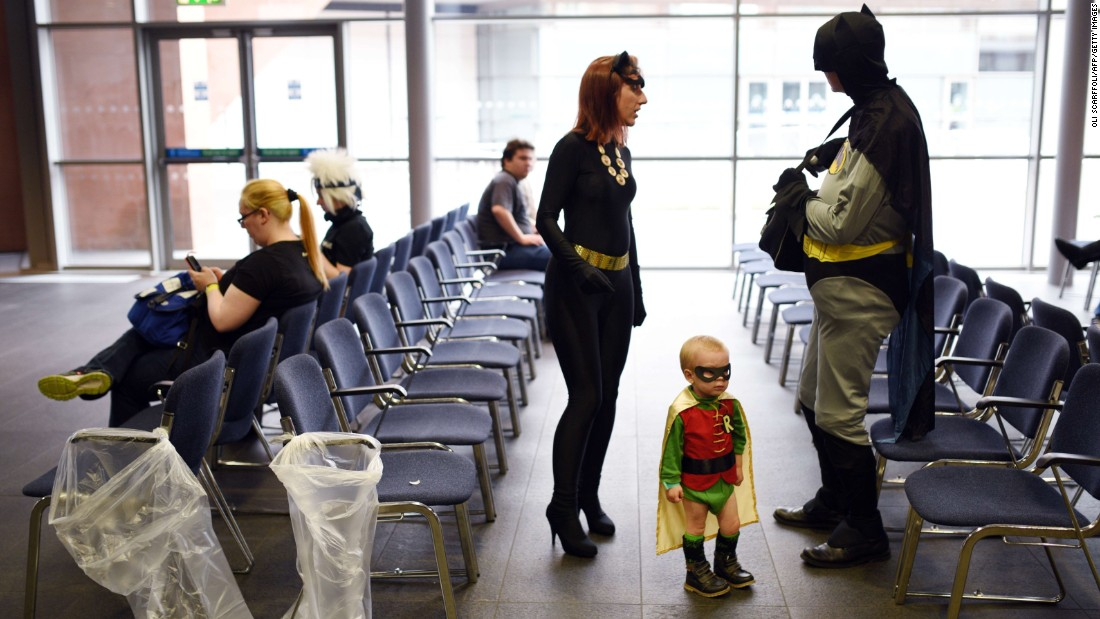 Conor and Natasha Lindop are dressed as Batman and Catwoman while their 2-year-old son, Dylan, is dressed as Robin at the MCM Comic Con in Manchester, England, on Sunday, July 26.