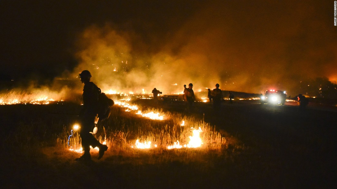 "The Rocky Fire burns near Clear Lake, California, on Wednesday, July 29. California <a href=""http://www.cnn.com/2015/07/18/us/gallery/ca-wildfire-2015/index.html"" target=""_blank"">has been battling wildfires</a> as its historic drought reaches a fourth year."