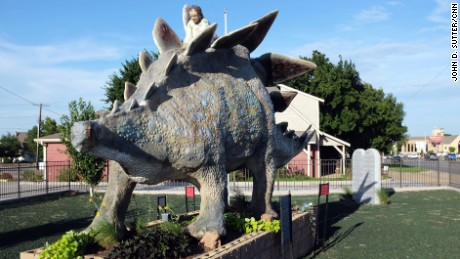 "A sign in front of this statue reads, ""A dinosaur like this roamed the Earth 5,000 years ago."""
