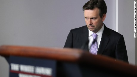 White House Press Secretary Josh Earnest arrives for the daily news briefing at the White House July 8, 2015 in Washington, D.C.