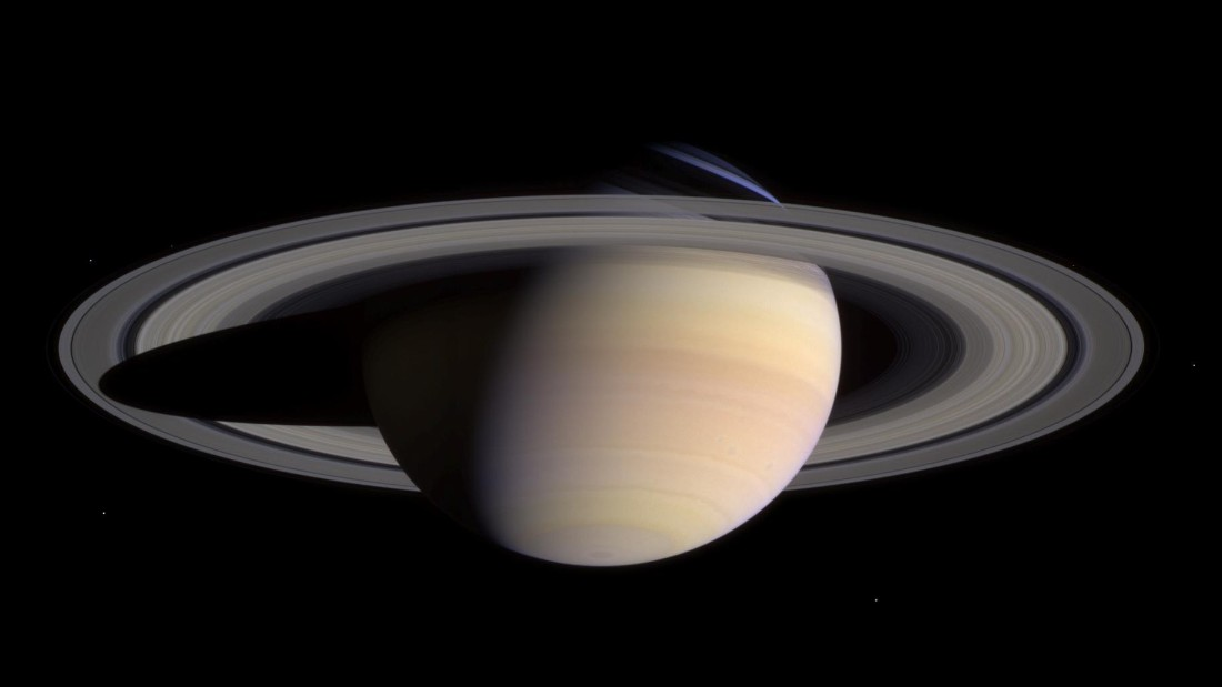Cassini spacecraft moves in for a closer look at Saturn. Two pictures taken during the spacecraft's approach to the planet in May 2004 were combined to create this mosaic of Saturn, its rings and several of its icy moons. Cassini was 17.6 million miles (28.2 million kilometers) from Saturn when the images were taken.