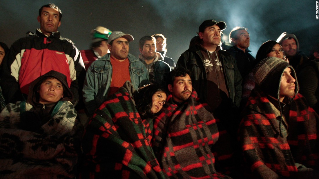 Relatives stand by as rescuers work to free 33 miners trapped inside the San Jose mine near Copiapo, Chile, on August 6, 2010. The mine collapsed a day earlier, and the miners ended up trapped 2,300 feet underground for more than two months. See how the rescue operation unfolded.