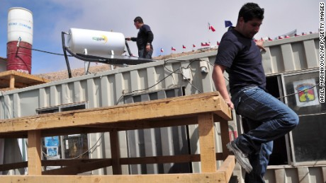 "Volunteers install heating and water purification systems at the La Esperanza encampment outside the San Jose mine on September 8. ""Esperanza"" means hope in English."