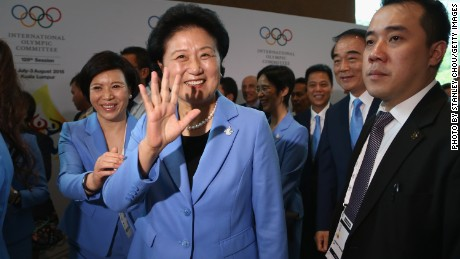 Liu Yandong, head of the Beijing 2022 Delegation, waves after placing her city's bid for 2022.