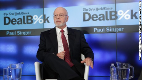 Founder and President, Elliot Management Corporation Paul Singer speaks onstage during The New York Times DealBook Conference at One World Trade Center on December 11, 2014 in New York City.