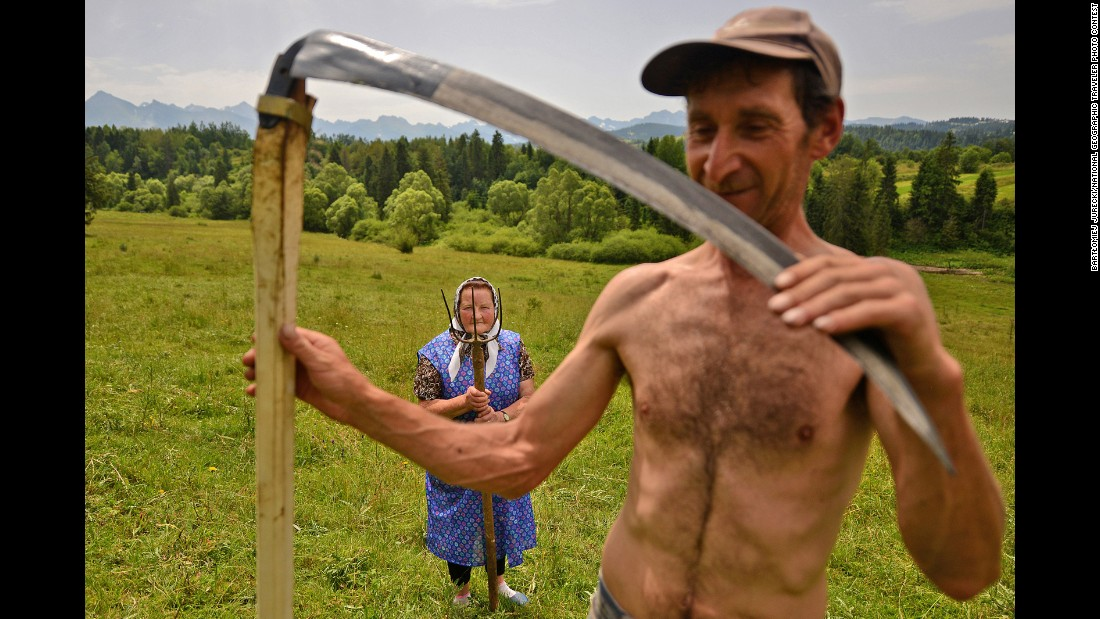 """Traditional haymaking in Poland,"" Jurecki said. ""Many people continue to use the scythe and pitchfork to sort the hay."""