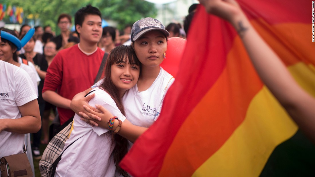 Marchers embrace each other during the pride parade on August 2 in Hanoi.