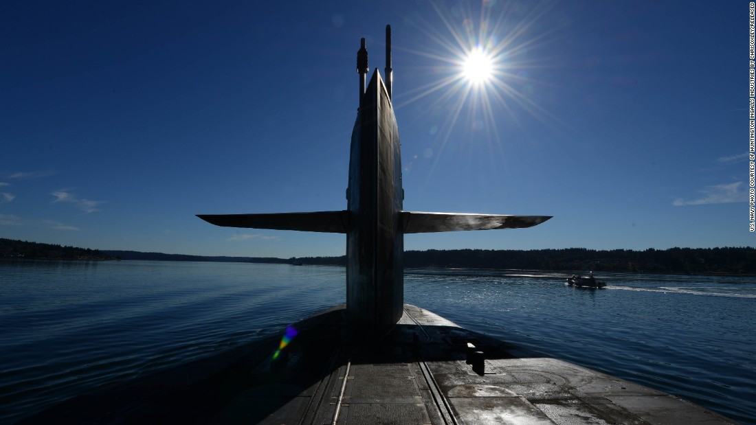 The Ohio-class guided missile submarine USS Ohio transits Puget Sound, Washington, in June 2015. The Ohio and three other guided-missile subs -- USS Florida, USS Michigan and USS Georgia -- were originally built and deployed as ballistic-missile subs, but were converted to guided-missile platforms beginning in 2002 after the Navy concluded it had a surplus of the boomers.