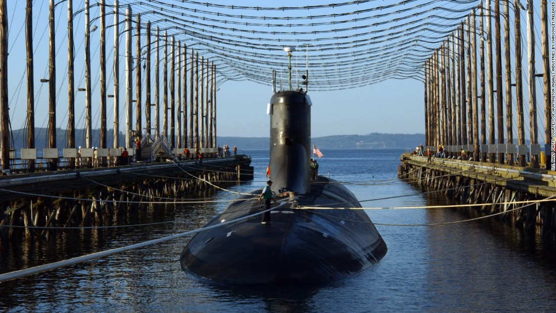 "The Seawolf-class attack submarine USS Jimmy Carter is moored in a Washington state facility that reduces a ship's electromagnetic signature in 2006. The Jimmy Carter is 100 feet longer than the first two subs in its class. The extra space is for a ""multimission platform,"" the Navy says. ""This hull section provides for additional payloads to accommodate advanced technology used to carry out classified research and development and for enhanced warfighting capabilities."""