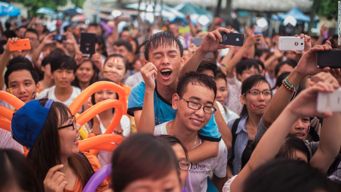 A crowd revel in a performance during the parade on August 2 in Hanoi.
