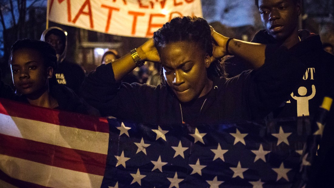 Image #: 33361141    Protesters, demanding the criminal indictment of a white police officer who shot dead an unarmed black teenager in August, march through a suburb in St. Louis, Missouri November 23, 2014. After a fourth straight night of low-level protests in Ferguson, Missouri, anxious residents still did not know on Sunday when a grand jury would return a decision on whether to charge a white policeman who shot an unarmed black teen to death this summer. It appeared that the St. Louis suburb, which has become a flashpoint for U.S. race relations since Officer Darren Wilson killed 18-year-old Michael Brown on Aug. 9, would have to wait until at least Monday and perhaps longer for an announcement.  REUTERS/Adrees Latif  (UNITED STATES - Tags: CRIME LAW CIVIL UNREST POLITICS TPX IMAGES OF THE DAY)       REUTERS /ADREES LATIF /LANDOV