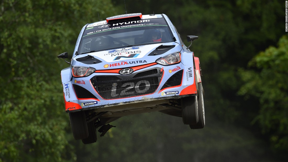 The rally car of Daniel Sordo and Marc Marti goes airborne during a race in Jyvaskyla, Finland, on Friday, July 31.