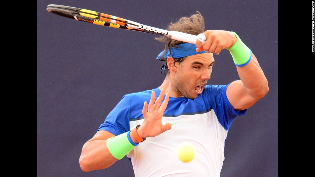 Rafael Nadal hits a shot at the German Open on Thursday, July 30. He won the tournament several days later, defeating Fabio Fognini in the final.