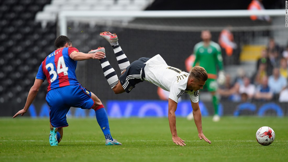 Fulham's Alexander Kacaniklic is upended by Crystal Palace's Martin Kelly during a preseason match in London on Saturday, August 1.