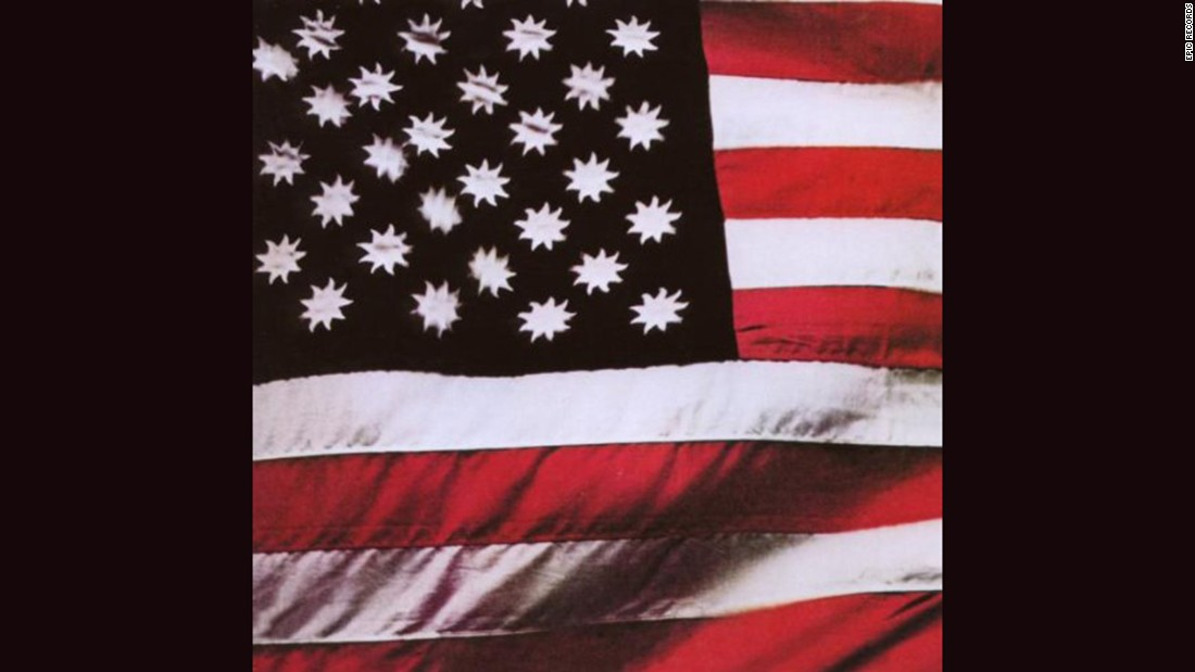 "<strong>""There's a Riot Goin' On,"" Sly and the Family Stone</strong>: Steve Paley's photograph of an American flag with suns in place of stars (on a black field) served as the cover of Sly's 1971 album, but in later years it was replaced by <a href=""http://ecx.images-amazon.com/images/I/51jVueymJML._SY300_.jpg"" target=""_blank"">a picture of the band in concert</a>."