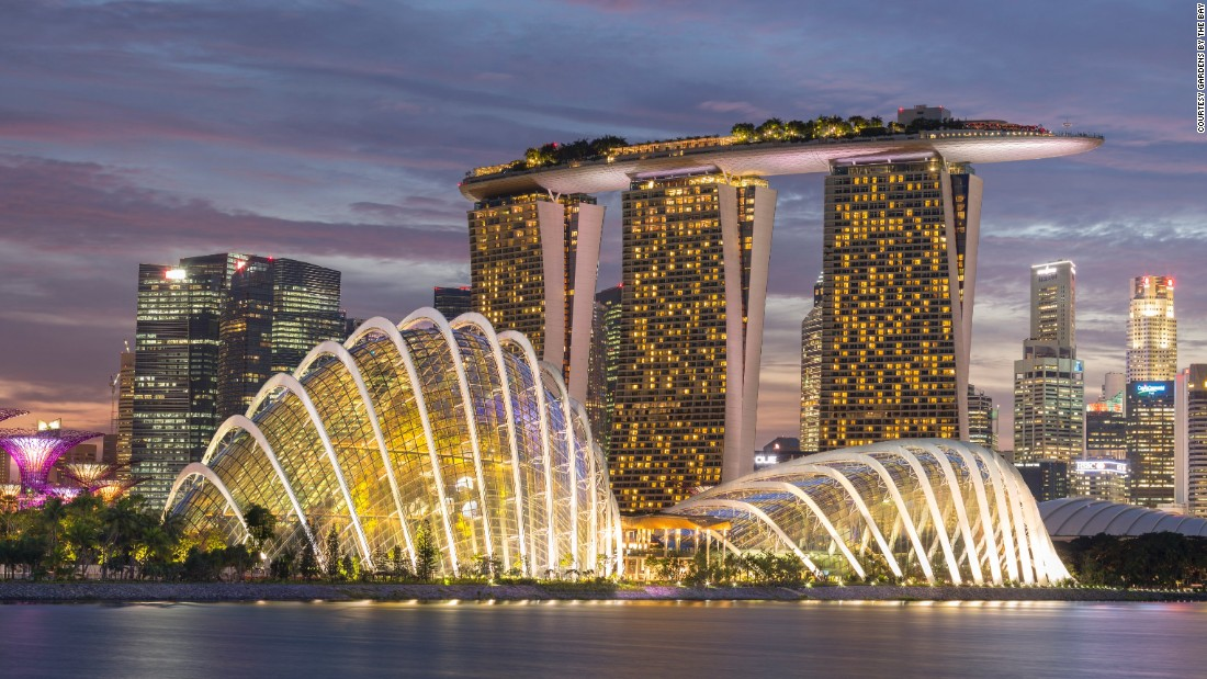 Singapore is home to two of the world's three most expensive buildings (including the three-towered Marina Bay Sands, pictured), a concert hall shaped like a durian and a museum shaped like a robotic hand.