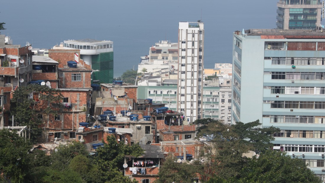 "The view from Milvvia Goncalves' two-bedroom home in Rio's Cantagalo -- or ""Rooster's Crow"" -- neighborhood. Filled with stacks of brick and cement homes, this favela was dominated by violent drug gangs until just a couple of years ago."