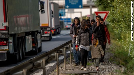 Migrants who managed to get past roadblocks set up by French gendarmes inside the Eurotunnel site walk to the boarding platform to attempt to reach Britain, in Coquelles near Calais, northern France, on July 31, 2015. The situation appears to have calmed in the past two days, after migrants made more than 2,000 daily attempts to breach the defences earlier in the week. The crisis has strained relations between Paris and London and the British government was poised to hold emergency talks later on July 31 on the issue. AFP PHOTO / PHILIPPE HUGUENPHILIPPE HUGUEN/AFP/Getty Images