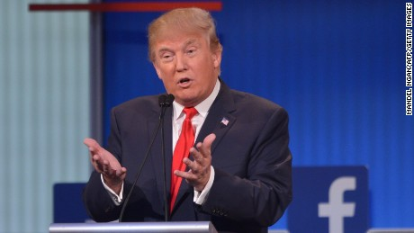 Real estate tycoon Donald Trump participates in the Republican presidential primary debate on August 6, 2015 at the Quicken Loans Arena in Cleveland, Ohio.