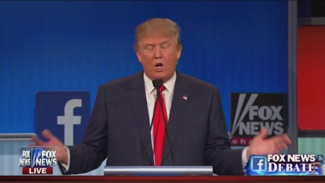 Donald Trump Fox News GOP debate Republican party pledge raises hand_00013011