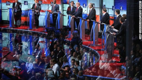 Audience members are reflected in a window as Republican presidential candidates (L-R) New Jersey Gov. Chris Christie, Sen. Marco Rubio (R-FL), Ben Carson, Wisconsin Gov. Scott Walker, Donald Trump, Jeb Bush, Mike Huckabee, Sen. Ted Cruz (R-TX), Sen. Rand Paul (R-KY) and John Kasich participate in the first prime-time presidential debate hosted by FOX News and Facebook at the Quicken Loans Arena August 6, 2015 in Cleveland, Ohio.