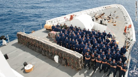 The Coast Guard Cutter Stratton crew with cocaine bales seized.