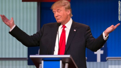 Republican presidential candidate Donald Trump gestures during the first Republican presidential debate at the Quicken Loans Arena Thursday, Aug. 6, 2015, in Cleveland. (AP Photo/John Minchillo)