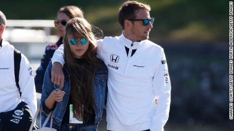 MONTREAL, QC - JUNE 06:  Jenson Button of Great Britain and McLaren and Jessica Michibata arrive at the circuit prior to final practice for the Canadian Formula One Grand Prix at Circuit Gilles Villeneuve on June 6, 2015 in Montreal, Canada.  (Photo by Charles Coates/Getty Images)