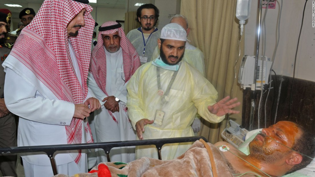 "The governor of the Asir region in Saudi Arabia, Prince Faisal bin Khaled bin Abdulaziz, left, visits a man who was wounded in <a href=""http://www.cnn.com/2015/08/06/middleeast/saudi-arabia-mosque-attack/"" target=""_blank"">a suicide bombing attack on a mosque</a> in Abha, Saudi Arabia, on August 6. ISIS claimed responsibility for the explosion, which killed at least 13 people and injured nine others."
