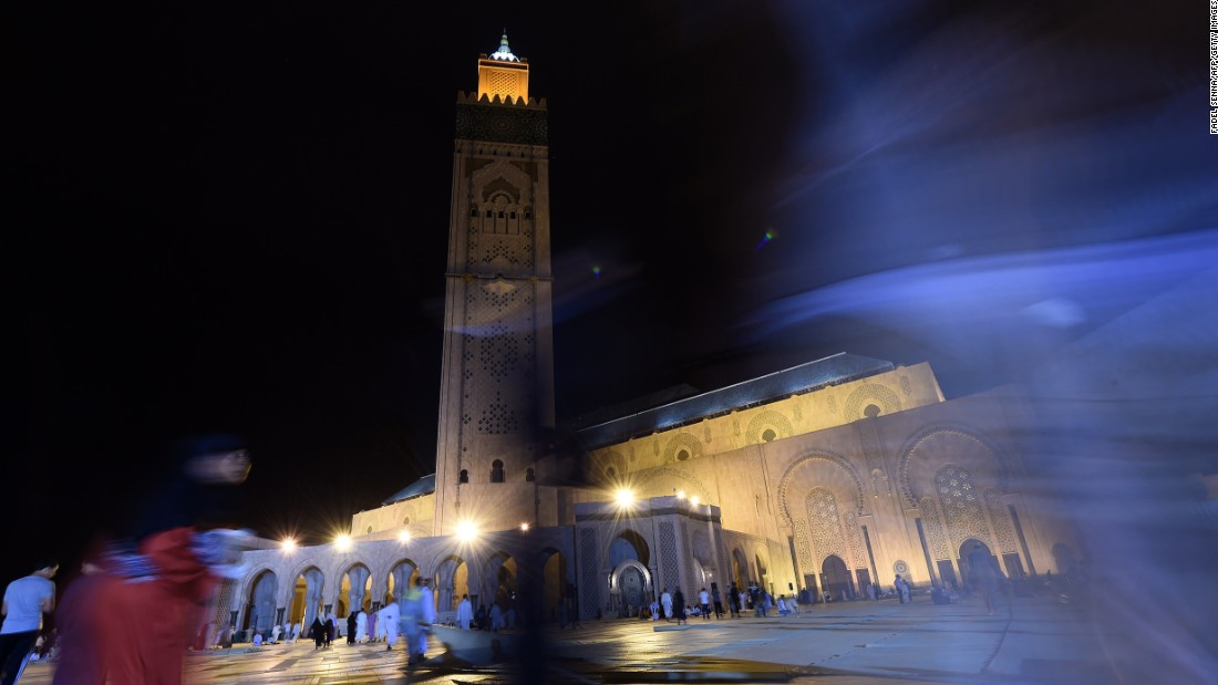 "Moroccan Muslims arrive at Hassan II mosque in Casablanca late on July 24 , 2014 to perform the ""Lailat al-Qadr"" (Night of Destiny) prayer which falls on the 27th day of the holy fasting month of Ramadan. ""Lailat al-Qadr"" marks the revelation of the Koran, Islam's holy book, to the Prophet Mohammed through the archangel Gabriel during the fasting month of Ramadan.   AFP PHOTO / FADEL SENNA        (Photo credit should read FADEL SENNA/AFP/Getty Images)"