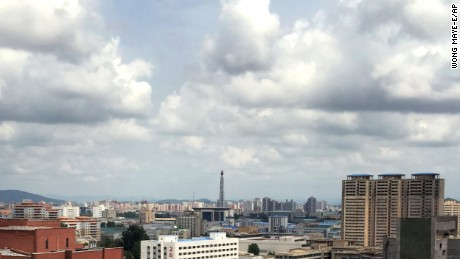 Clouds hang over the Juche Tower, Sunday, July 26, 2015, in Pyongyang, North Korea. The rainy season in North Korea usually starts in the month of July.