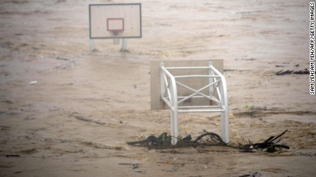 basket stadium is flooded by the Jingmei river as typhoon Soudelor hits Taipei on August 8, 2015. Typhoon Soudelor battered Taiwan with fierce winds and rain leaving four people dead and a trail of debris in its wake as it takes aim at mainland China. AFP PHOTO / Sam YehSAM YEH/AFP/Getty Images