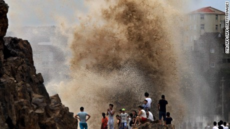 Residents gather to see huge waves stirred up by Typhoon Soudelor in in Wenling, China as the storm draws near the mainland  on August 8.